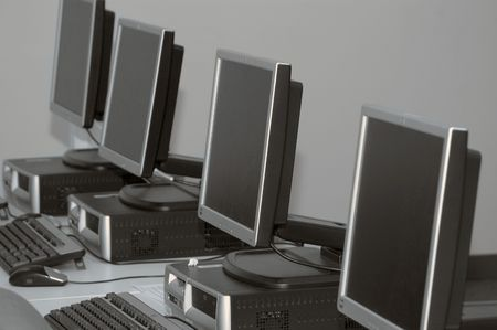 Row of computers set up for training at a classsroom Stock Photo - 6231566