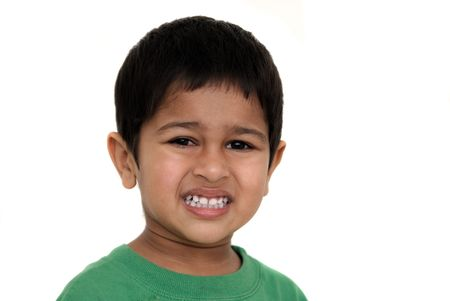 An handsome Indian kid irritated at something photo