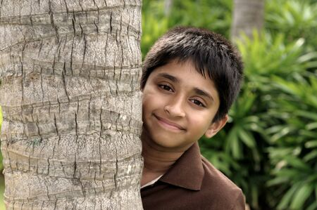 eagerly: handsome indian kid looking eagerly to the camera