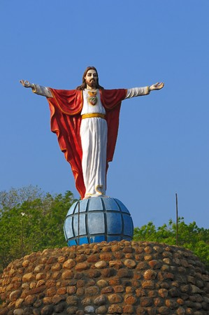 Statue of Jesus with arms extended at a loal church in Chennai India photo