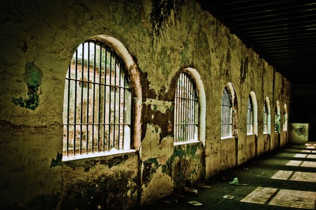 An old deserted jail on a bright sunny day