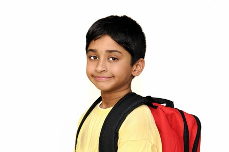 An handsome Indian kid getting ready for school photo