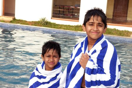 Handsome Indian brothers after a pool session photo
