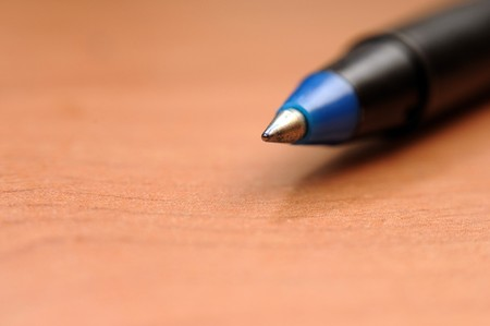Writing pen isolated on the brown background