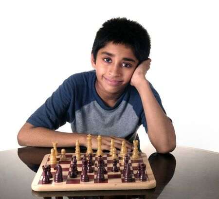 indian kid: A handsome Indian kid playing chess game