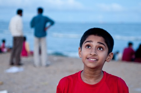 Portrait of a handsome Indian boy at the beach photo