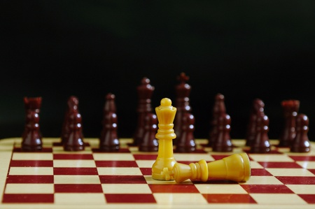 King fallen at the feet of queen in a chess game Stock Photo - 8486137