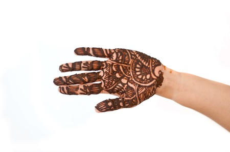 hands beautifully decorated with colorful herbs photo