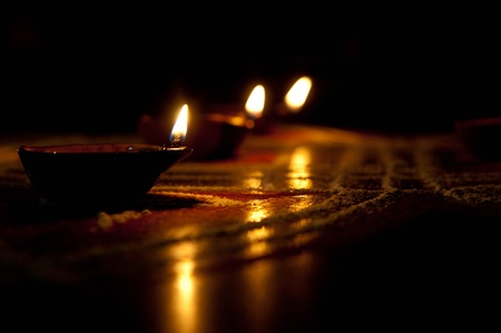 lit lamp: A mud lamp lit on the auspicious occasion of diwali