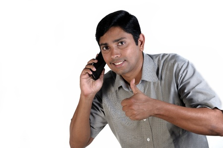 An handsome Indian businessman on call all the time photo