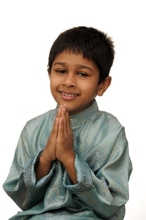 namaste: An hanbdsome young Indian child smiling for you