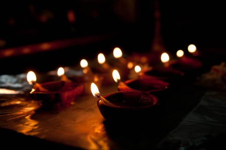 A mud lamp lit on the auspicious occasion of diwali photo