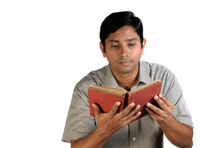 An handsome middle aged man reading an old book photo