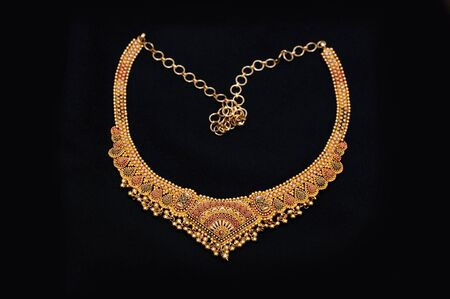 an authentic indian jewellery isolated on black background photo