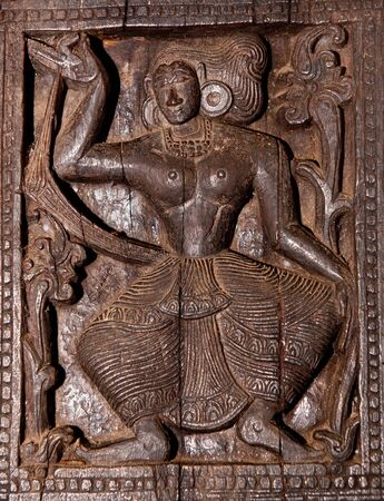 Famous ancient wood carvings at Embekke Temple near Kandy SriLanka photo