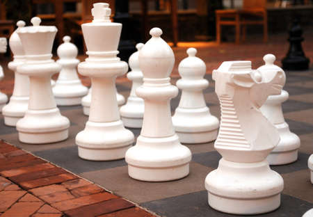 chellange: Large chess pieces at a local downtown ready for playing Stock Photo