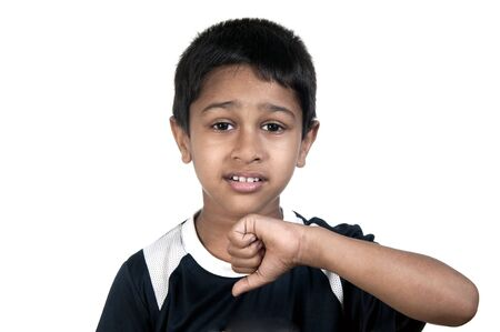 an handsome young indian kid showing thumbs down photo