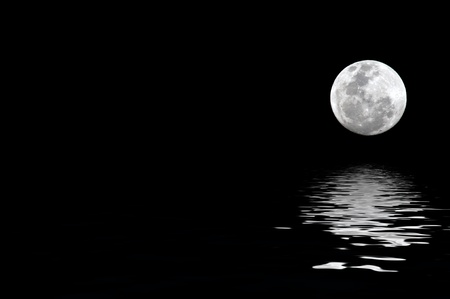 with reflection: full moon with water reflection with copy space to the left