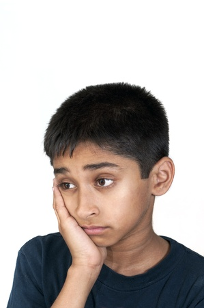 poverty in india: An handsome Indian kid looking very sad