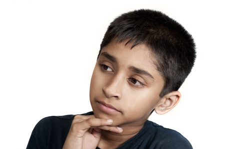 An handsome young kid thinking about something photo
