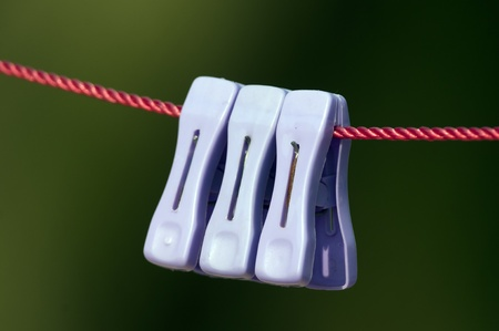 a set of colorful clips on a drying cord Stock fotó