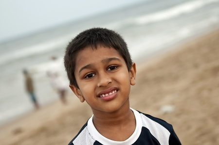 An handsome young Indian boy having fun  at the beach Stock Photo - 9259066