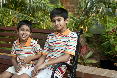 Two Indian brothers sitting happily at a local park Stock Photo - 9258995