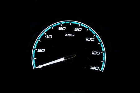 brightly lit: A brightly lit speedometer in a dark background Stock Photo