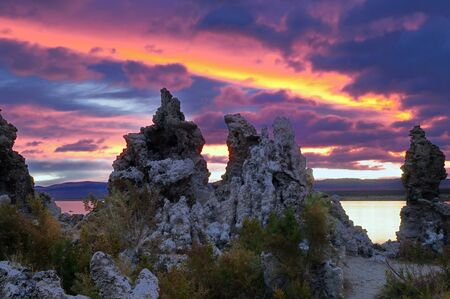Sky in fire at mono lake with stufas in the foreground