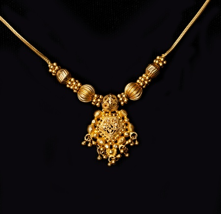 diamond necklace: an authentic indian jewellery isolated on black background