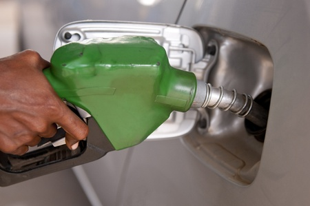 close-up of a mens hand refilling the car with a gas pump Stock Photo - 9663008
