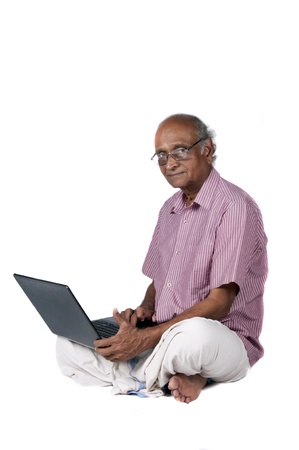 an old Indian man surfing the net after retirement photo