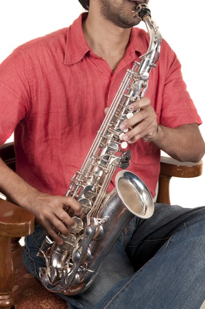 tenor: A jazz musician playing saxophone on a white background Stock Photo