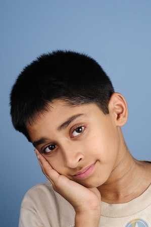 Portrait of an handsome young indian kid smiling