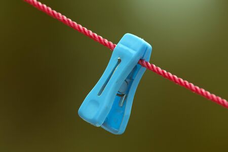 clothespin: Colorful clip hanging on a cord used for drying cloths Stock Photo