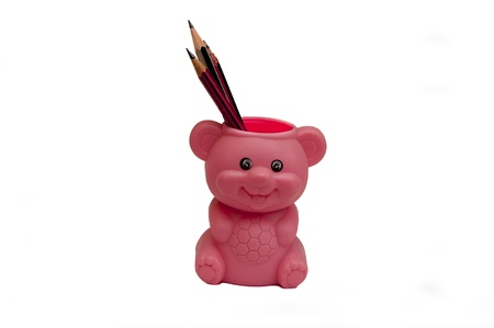 A cute pencil holder isolated on a white background photo