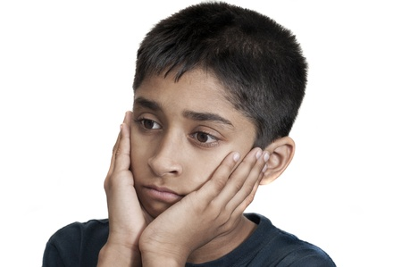 An handsome Indian kid looking very sad Stock Photo - 13396641