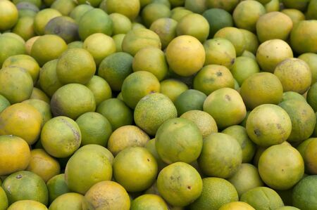 Fresh Sweet lime fruit on sale at a local market photo