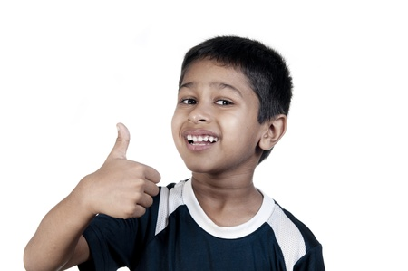An handsome indian kid looking very excited photo