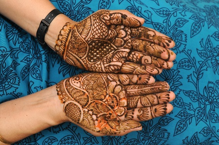 a design on hands against a black background photo
