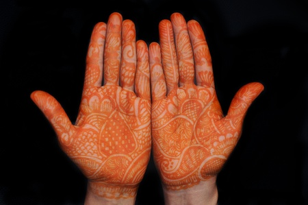 mehandi: a design on hands against a black background Stock Photo