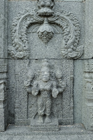 intricate artwork at ancient hindu temple photo