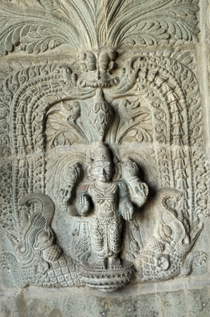 monument in india: intricate artwork at ancient hindu temple Stock Photo