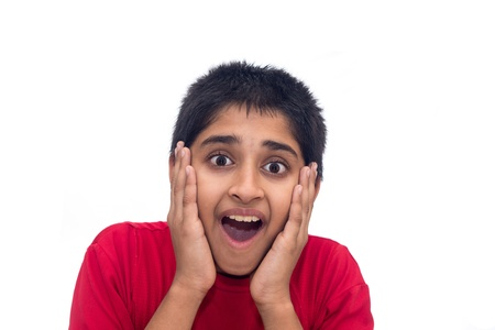 A handsome indian kid looking very excited Stock Photo