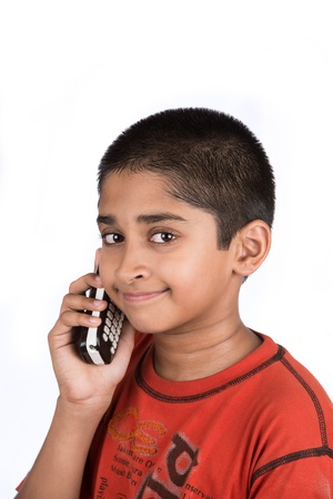 talkative: Handsome Indian kid looking very happy talking on phone