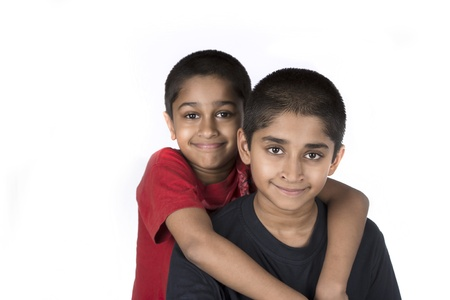 Indian brothers smiling happily against a white background Stock Photo - 16292895