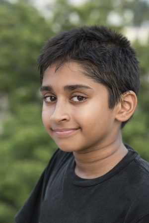 indian boy: Handsome Indian boy standing outdoor smiling