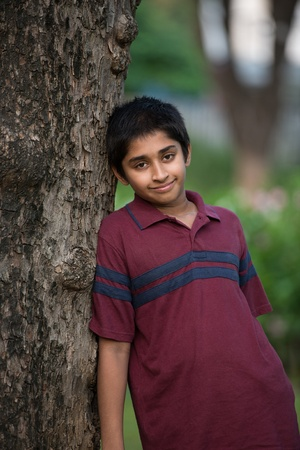cousin: Handsome Indian toddler standing outdoor smiling