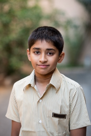 Handsome Indian boy ready to go to school photo