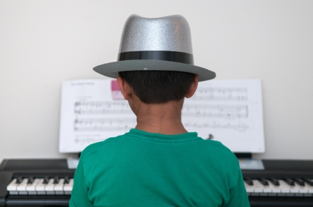 grand kid: An asian toddler performing at the piano Stock Photo